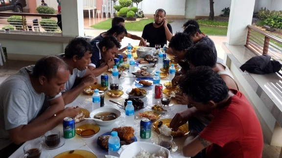 Indonesian sailors eat a meal after being freed in Sulu province in the southern Philippines.