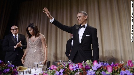 U.S. President Barack Obama waves to the audience after speaking at his final White House Correspondents' Association dinner.