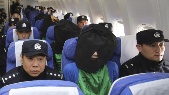In this photo released by Xinhua News Agency, Chinese suspects involved in wire fraud, center, sit in a plane as they arrive at the Beijing Capital International Airport in Beijing on Wednesday, April 13, 2016. The deportation of nearly four dozen Taiwanese that's part of a larger group including mainland Chinese from Kenya to China where they are being investigated over wire fraud allegations is focusing new attention on Beijingís willingness to assert its sovereignty claim over the Taiwan, and the leverage it wields over smaller nations in backing that position.(Yin Gang/Xinhua News Agency via AP) NO SALES