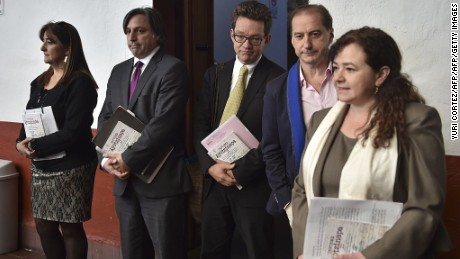 Members of Interdisciplinary Group of Independent Experts (GIEI) pose for a picture before reading their final report ont the disappearance of 43 students from the Ayotzinapa teachers school, in Mexico City on April, 24, 2016. / AFP / YURI CORTEZ        (Photo credit should read YURI CORTEZ/AFP/Getty Images)