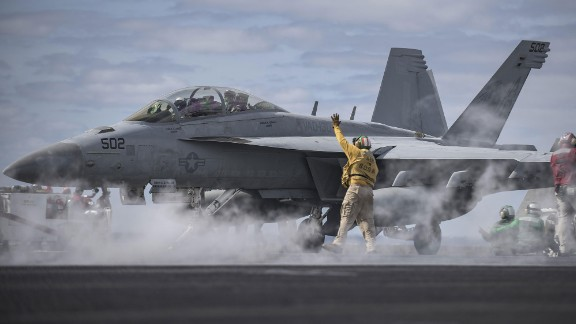 U.S. Navy Chief Warrant Officer 3 Hector Arroyo signals to an E/A-18G Growler, assigned to the Electronic Attack Squadron (VAQ) 130, on the flight deck of the aircraft carrier USS Dwight D. Eisenhower (CVN 69) in the Atlantic Ocean, April 11, 2016. The Eisenhower was underway preparing for an upcoming scheduled deployment. (U.S. Navy photo by Mass Communication Specialist 3rd Class J. Alexander Delgado)
