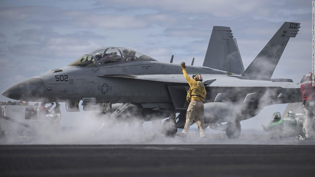 A U.S. Navy officer signals to an EA-18G Growler on the flight deck of the USS Dwight D. Eisenhower on Monday, April 11. The aircraft carrier was in the Atlantic Ocean preparing for a scheduled deployment.