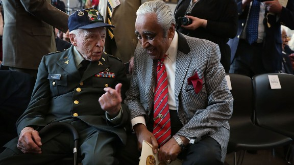 U.S. Rep. Charles Rangel, right, listens to retired Army Col. John Palese before a medal ceremony in Washington on Wednesday, April 13. The Congressional Gold Medal was awarded to Palese and other members of the 65th Infantry Regiment -- a Puerto Rican unit that served in World War I, World War II and the Korean War.