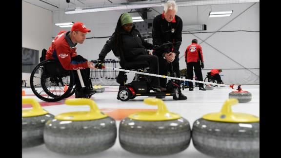 Disabled U.S. veterans take part in a curling camp in Denver on Thursday, April 14.
