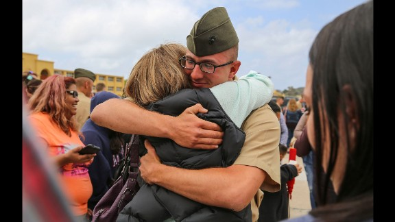 A U.S. Marine hugs a loved one after recruits were released to their families in San Diego on Thursday, April 28. Graduation was the next day.