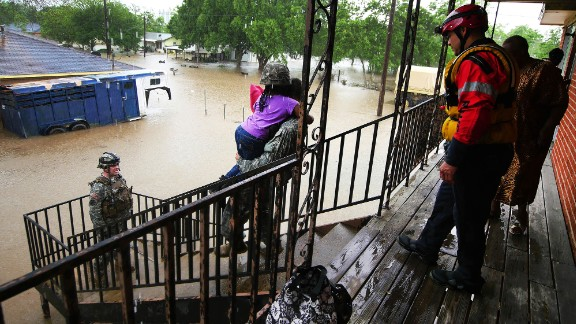 Soldiers and rescue personnel from the Texas Army National Guard help stranded residents during severe flooding in Wharton, Texas, on Thursday, April 21.