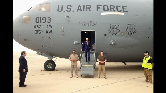 "U.S. Vice President Joe Biden steps off a military transport plane upon arriving in Baghdad, Iraq, on Thursday, April 28. Biden was making <a href=""http://www.cnn.com/2016/04/28/politics/joe-biden-iraq-unannounced-visit/index.html"" target=""_blank"">an unannounced trip</a> to meet with political leaders."