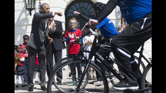 U.S. President Barack Obama gives a fist-bump at the start of the Wounded Warrior Ride in Washington on Thursday, April 14.