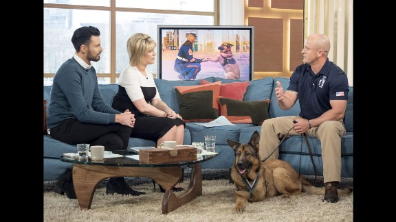 """Marine Gunnery Sgt. Chris Willingham, right, appears on a morning show in London with Lucca, a retired military dog <a href=""""http://www.cnn.com/2016/04/05/us/lucca-marine-dog-medal-honor-irpt/"""" target=""""_blank"""">who lost her leg</a> when an IED detonated underneath her in 2012. Lucca successfully completed 400 missions and protected the lives of thousands of troops during her six years of service, according to a statement from The People's Dispensary for Sick Animals, a British organization known as PDSA. She was given the PDSA Dickin Medal, the highest honor animals can receive for their military service."""