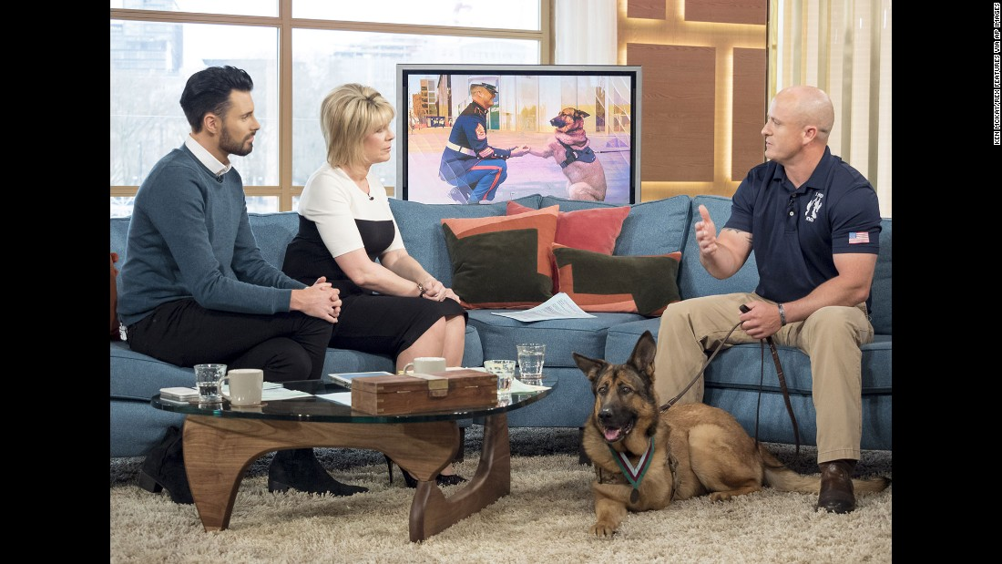 "Marine Gunnery Sgt. Chris Willingham, right, appears on a morning show in London with Lucca, a retired military dog <a href=""http://www.cnn.com/2016/04/05/us/lucca-marine-dog-medal-honor-irpt/"" target=""_blank"">who lost her leg</a> when an IED detonated underneath her in 2012. Lucca successfully completed 400 missions and protected the lives of thousands of troops during her six years of service, according to a statement from The People's Dispensary for Sick Animals, a British organization known as PDSA. She was given the PDSA Dickin Medal, the highest honor animals can receive for their military service."