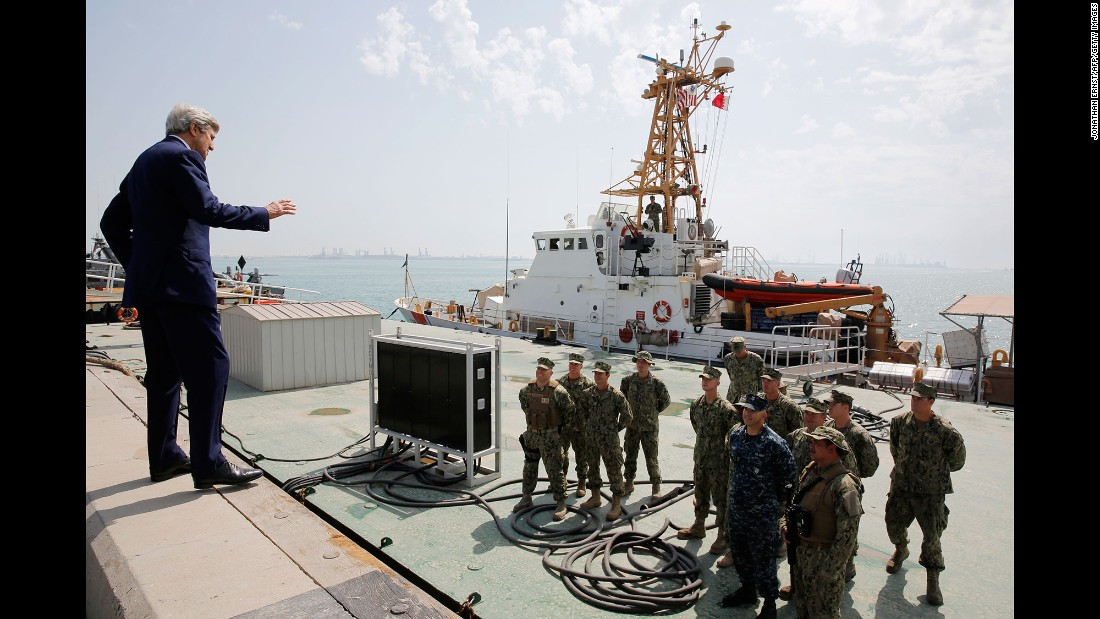 U.S. Secretary of State John Kerry talks with members of the Coast Guard as he tours a base in Manama, Bahrain, on Thursday, April 7.