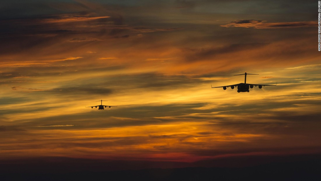 Two military transport planes prepare to drop soldiers during a tactical exercise in Fort Bragg, North Carolina, on Friday, April 15.