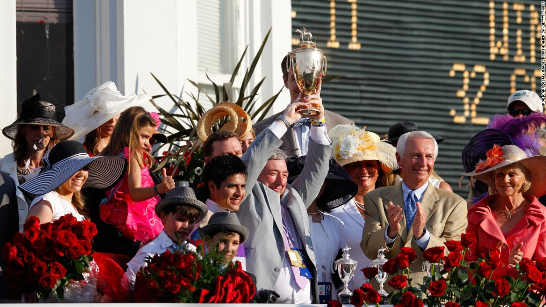 Reddam (C) and jockey Mario Gutierrez celebrate after I'll Have Another's Kentucky Derby success in 2012.