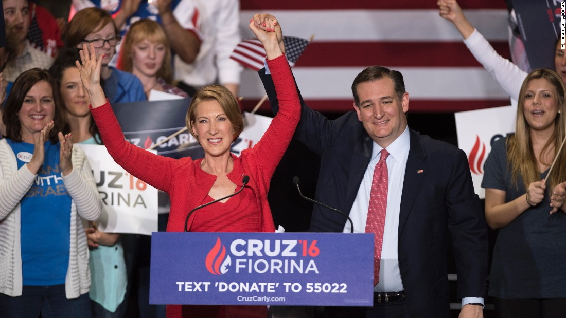 Cruz holds up the hand of Carly Fiorina at a campaign rally in Indianapolis on Wednesday, April 27. Cruz named Fiorina, a former presidential candidate, as his running mate.