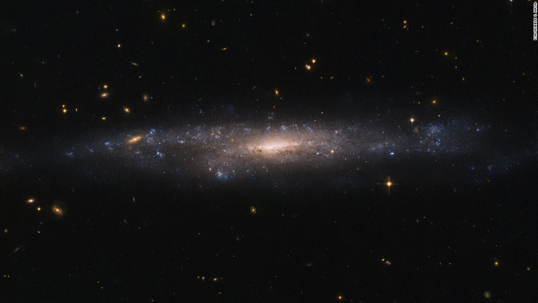 The Hubble Space Telescope captured an image of a hidden galaxy that is fainter than Andromeda or the Milky Way. This low surface brightness galaxy, called UGC 477, is over 110 million light-years away in the constellation of Pisces.