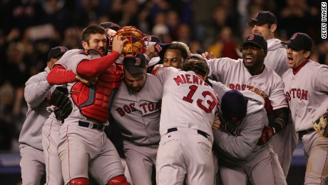 Red Sox players celebrate their win over the New York Yankees in game seven in 2004.