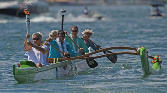 Canoeist Rubens Pompeu carried the Olympic flame on an outrigger canoe at Lake Paranoa. The torch will be carried in a relay by 12,000 people throughout its journey across the country.