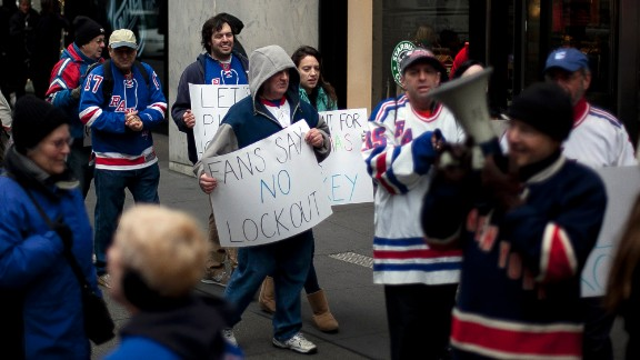 NEW YORK, NY - DECEMBER 1: Hockey fans protest the National Hockey League (NHL) lockout outside the NHL offices in midtown Manhattan December 1, 2012 in New York City. (Photo by Allison Joyce/Getty Images)