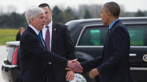 President Barack Obama shakes hands with Michigan Governor Rick Snyder upon his arrival in Flint, Michigan on May 4, 2016.