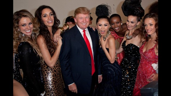 Trump poses with Miss Universe contestants in 2011. Trump had been executive producer of the Miss Universe, Miss USA and Miss Teen USA pageants since 1996.