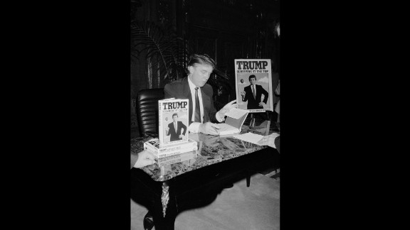 "Trump signs his second book, ""Trump: Surviving at the Top,"" in 1990. Trump has published at least 16 other books, including ""The Art of the Deal"" and ""The America We Deserve."""