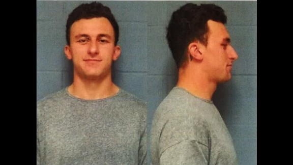 Football player Johnny Manziel turned himself turned himself in to police in Highland Park, Texas, on Wednesday, May 4, and was booked on misdemeanor assault charges, said Lt. Lance Koppa with the Highland Park Department of Public Safety. Manziel is accused of assaulting his former girlfriend in January. He has denied hitting her, and his lawyer said he'll plead not guilty.