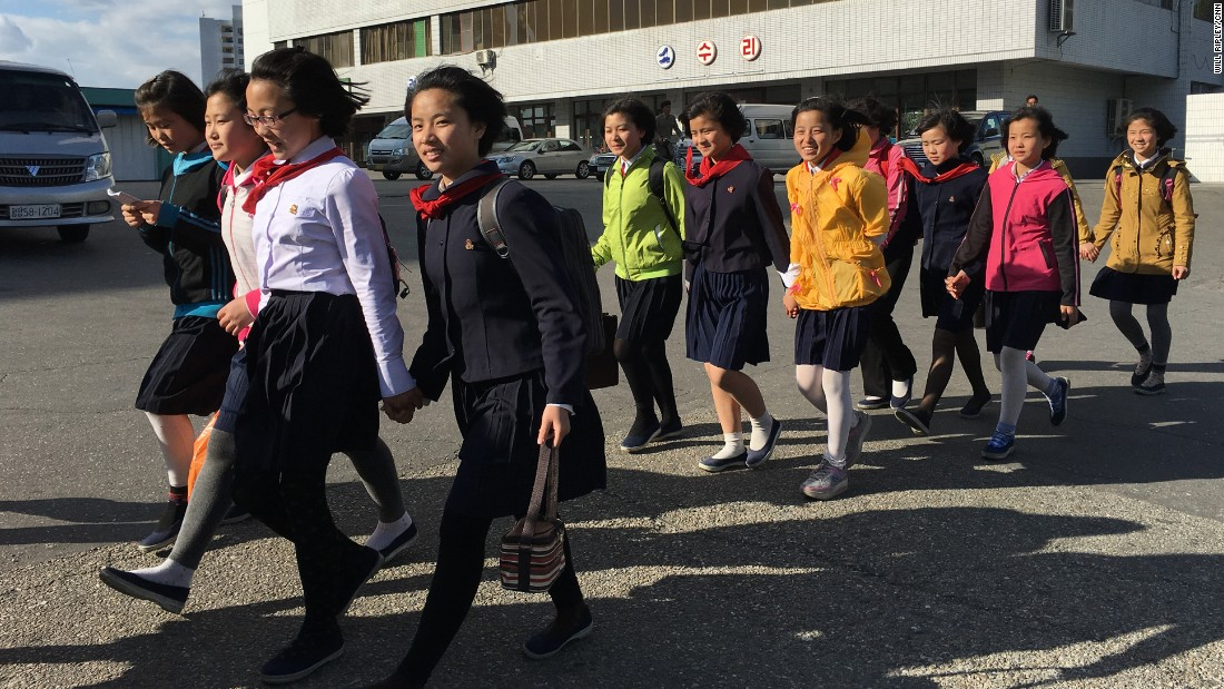 "Secondary school students walk home in a group along Kwangbok ""Liberation"" street in Pyongyang on May 4 after a day of work and rehearsals for the upcoming congress."