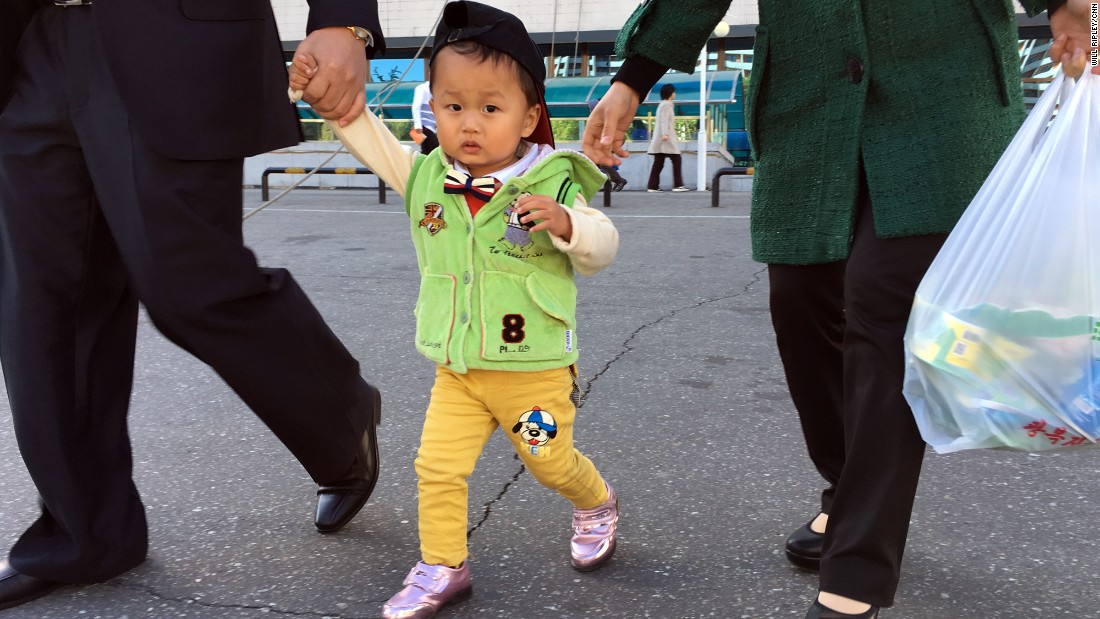 A growing number of Pyongyang's upper-middle class are able to purchase fashionable clothing, usually imported from China. Two-year-old Ri Ryong Won's mother is a primary school teacher.