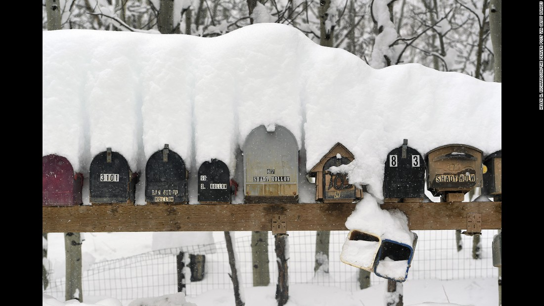 Mailboxes are covered with snow in Nederland, Colorado, on Sunday, April 17.