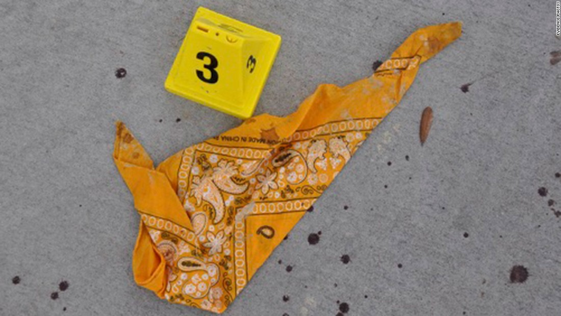 A bloody bandana lies on the sidewalk outside of Twin Peaks. Both clubs, the Bandidos and the Cossacks, say they're done fighting.