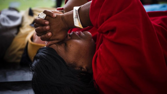 """Linda Wilder-Bryan,  whose son Lawrence was killed in a shooting in August, prays during a """"die in, lay in"""" protest this year."""