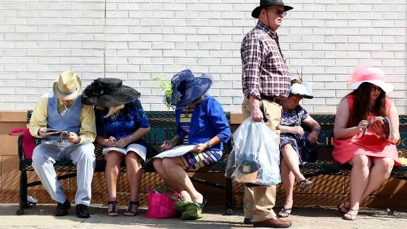 Race-goers analyze programs at last year's Derby.