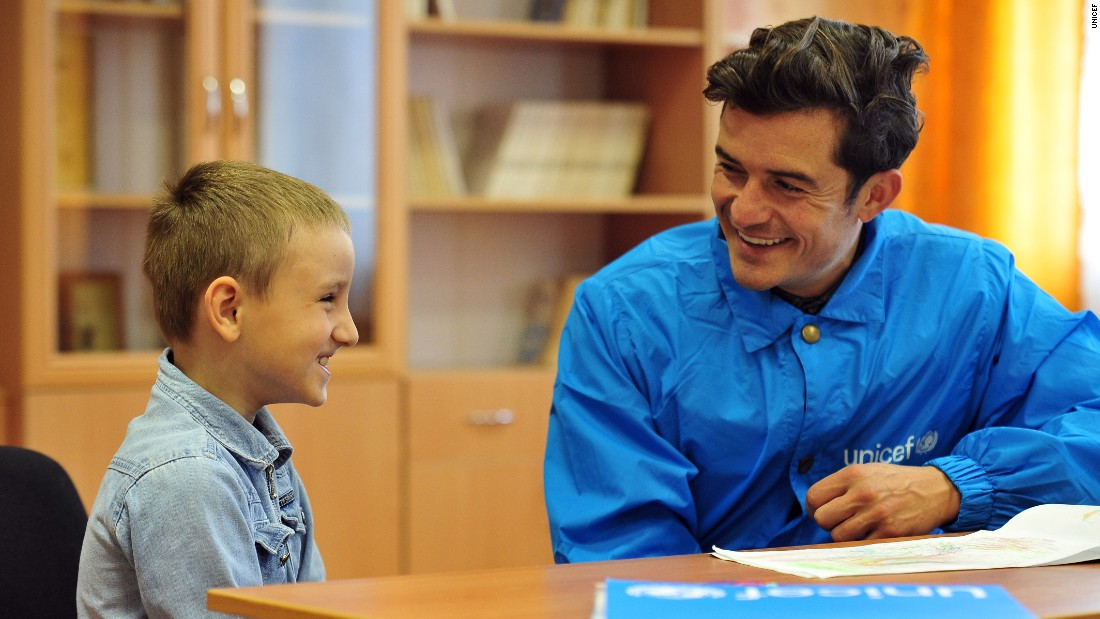 A pupil at School #2 in Myronivskyi, near the front line in conflict-torn eastern Ukraine, meets with Orlando Bloom.
