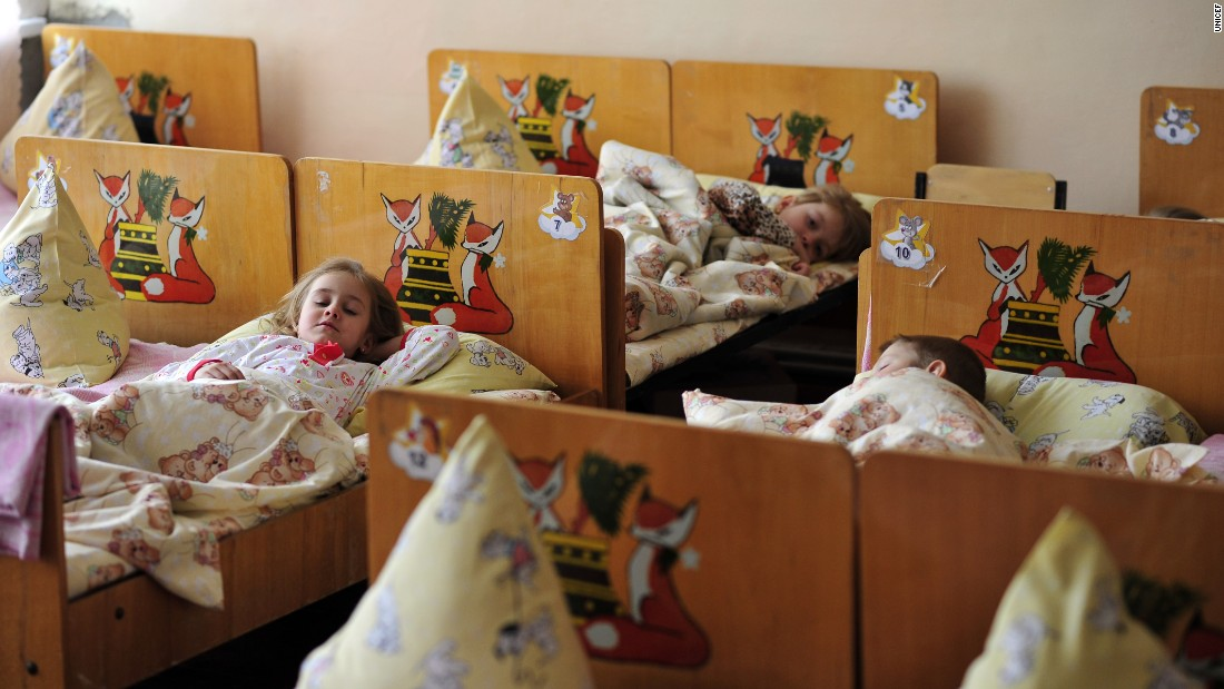 Children take their afternoon nap at Kindergarten 'Veselka' in Svitlodarsk, eastern Ukraine. The school was heavily damaged by shelling at the beginning of 2015, with children and teachers sheltering in the basement during the bombardment.
