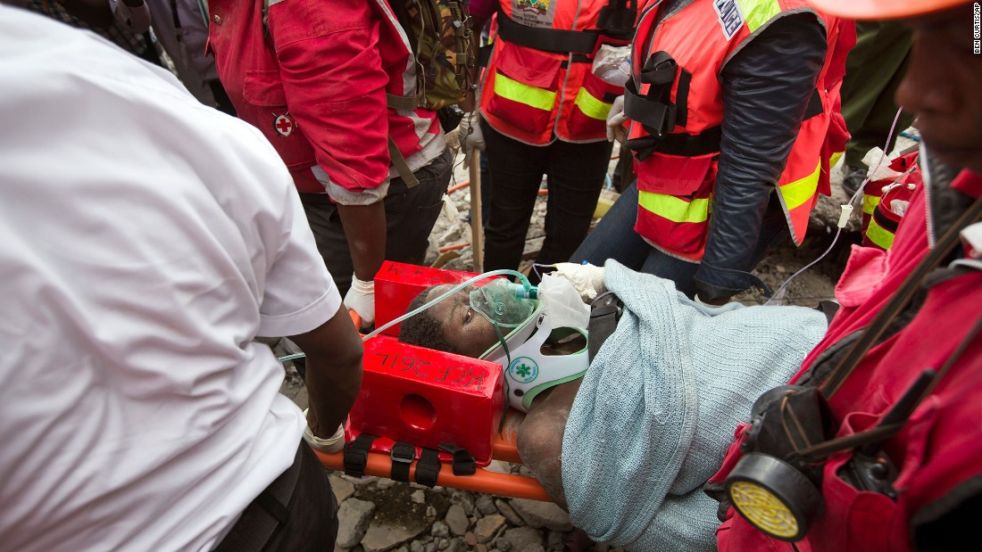 "Medics carry a woman on May 5, 2016, after she was pulled from the rubble of a collapsed building in Nairobi, Kenya. She was trapped in the rubble for six days. Click through for more amazing stories of survival, including the saga of Chilean miners, a man aboard the Costa Concordia and the ""miracle babies"" of the Mexico earthquake."