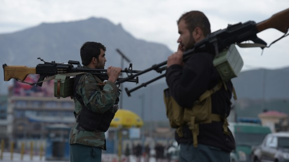 Afghan security personnel guard the site of car bomb attack in Kabul last month.