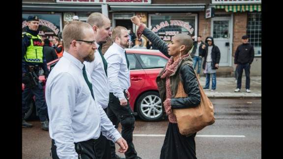 Tess Apslund, 42, stands with a raised fist in front of uniformed neo-Nazis during a Nordic Resistance Movement demonstration in Borlange, Sweden, on Sunday, May 1.
