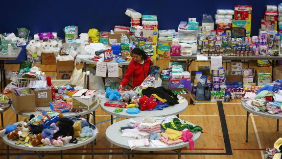 A woman picks through donated clothing and goods at a makeshift evacuation center in Lac la Biche on May 5.