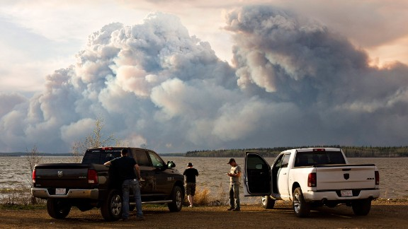 Evacuees watch the pyrocumulus form above the wildfire near Fort McMurray on May 4.