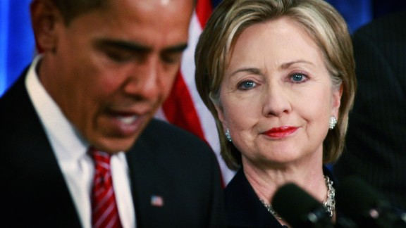 CHICAGO - DECEMBER 01:  President-elect Barack Obama (L) introduces Senator Hillary Clinton (D-NY) as his choice for secretary of state during a press conference at the Hilton Hotel December 01, 2008 in Chicago, Illinois. Other members of the National Security Team named by Obama at the press conference include Washington attorney Eric Holder as attorney general, Arizona Governor Janet Napolitano as his choice for homeland security and he said Robert Gates would remain as defense secretary.  Retired Marine Gen. James L. Jones was selected for the position of national security adviser and Susan Rice as U.N. ambassador.  (Photo by Scott Olson/Getty Images)