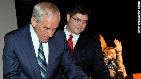Rep. Ron Paul, R-Texas, signs the back of a large copy of the United States Constitution for supporter Walter Zdazinsky as Paul's campaign manager, Jesse Benton, looks on at the Silverton Casino Lodge in Las Vegas, Nevada, on May 17, 2011.