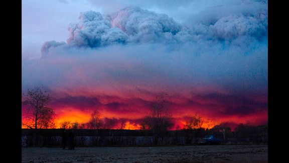A wildfire moves towards the town of Anzac from Fort McMurray, Alberta., on Wednesday May 4, 2016.