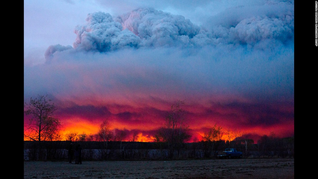 "A wildfire moves toward the town of Anzac, Alberta, on Wednesday, May 4. The wildfire <a href=""http://www.cnn.com/2016/05/05/world/gallery/canada-wildfire-fort-mcmurray/index.html"" target=""_blank"">has forced more than 80,000 people from their homes</a> in Fort McMurray and surrounding areas."
