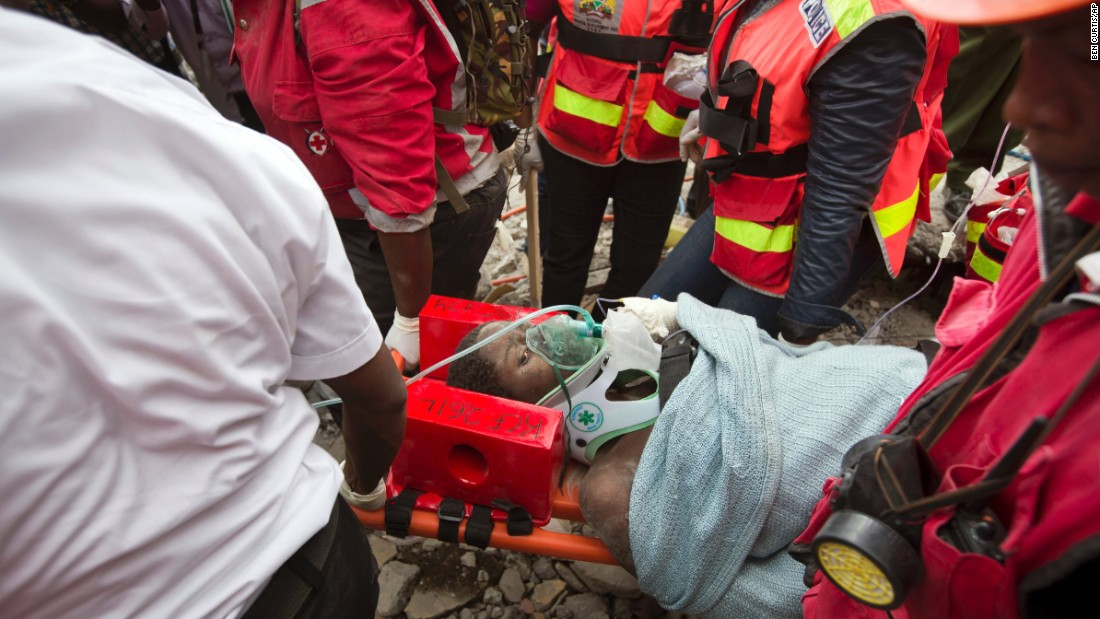 "Medics carry a woman after <a href=""http://www.cnn.com/2016/05/05/health/rubble-rescues/index.html"" target=""_blank"">she was pulled from the rubble of a collapsed building</a> in Nairobi, Kenya, on Thursday, May 5. She was trapped in the rubble for six days. <a href=""http://www.cnn.com/2016/05/03/africa/kenya-building-baby-rescue/"" target=""_blank"">A baby girl was also among those rescued</a> from the building, which fell as heavy rains inundated the city. At least 23 people were killed."