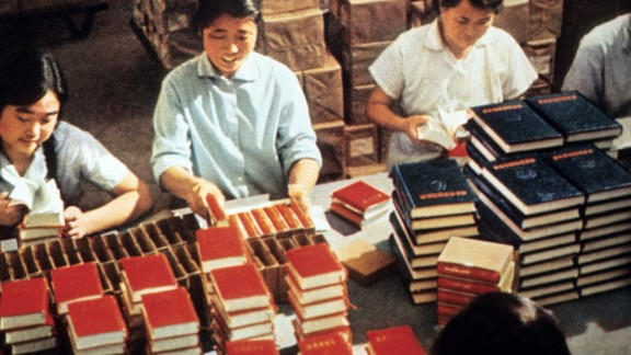 "Printing house workers in Beijing pack copies of Mao Zedong's ""Little Red Book,"" the bible of Maoist thought, during the Cultural Revolution."