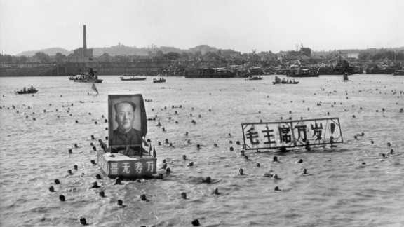 Hundreds of people follow Mao Zedong's example by swimming in the Yangtze near Wuhan in Hubei province.