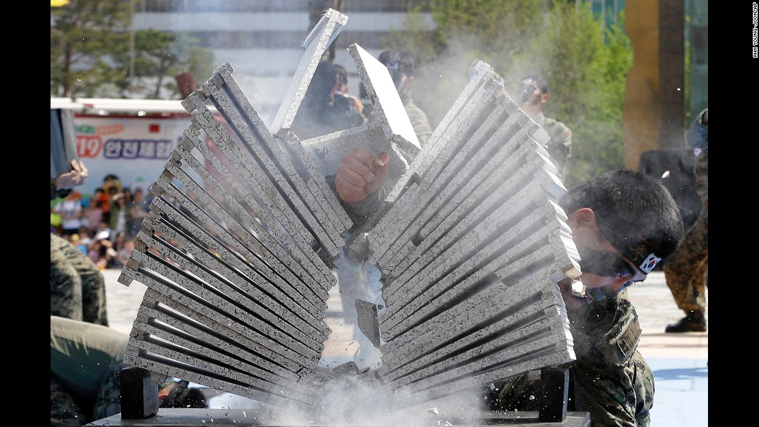 A soldier from the South Korean army breaks stone plates with his hand during a martial-arts demonstration in Seoul, South Korea, on Thursday, May 5.