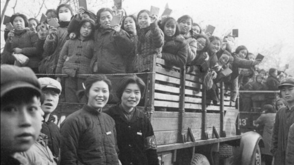 "Red Guards, high school and university students, brandish copies of Mao's ""Little Red Book."" Unleashed on the Party and the populace by Mao himself, the Red Guards went on to rampage throughout the country, terrorizing, killing and torturing people deemed ""class enemies."""