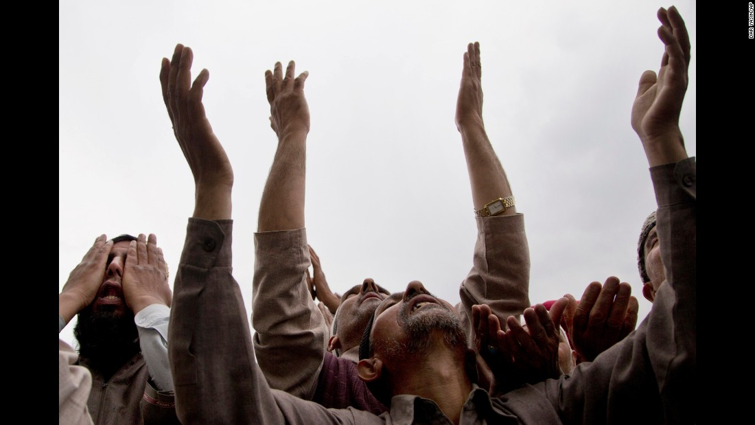 Kashmiri Muslims pray as a relic of the Prophet Muhammad is displayed in Srinagar, India, on Thursday, May 5.