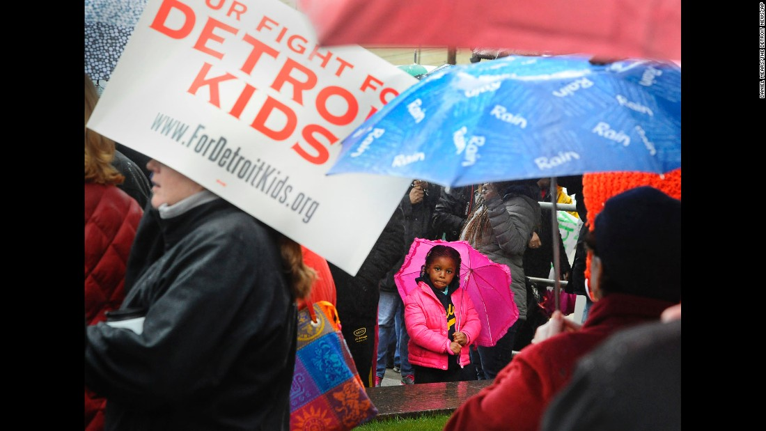 "Jordyn Dearing, 5, attends a rally of the Detroit Federation of Teachers on Monday, May 2. Almost all of Detroit's public schools were closed Monday and Tuesday after teachers, including Dearing's mother, <a href=""http://www.cnn.com/2016/05/03/us/detroit-schools-teacher-sickout/"" target=""_blank"">called in sick to protest the city's financial woes.</a> They were encouraged to return to the classroom Wednesday after assurances that they would be paid for the full school year."